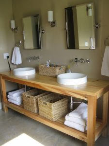 interior-simple-bathroom-remodeling-idea-with-rectangular-oak-wood-bathroom-table-designed-with-square-legs-and-shelf-plus-wicker-boxes